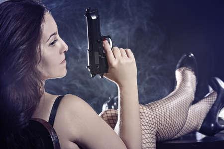 Pretty girl with a gun