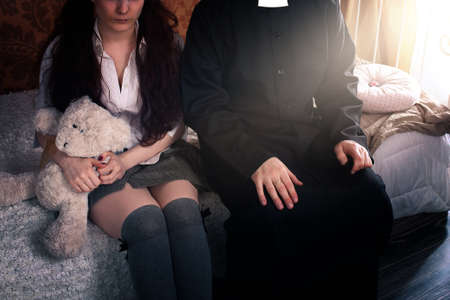 Photo pour priest and young girl in a skirt - image libre de droit
