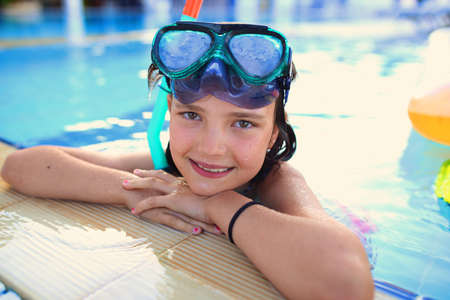 Photo for Joyful and smiling young girl in a diving mask in the pool - Royalty Free Image