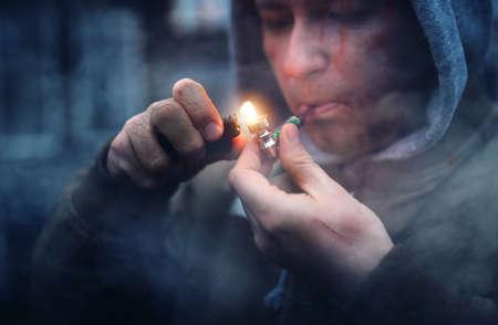 Photo pour addicted man smokes marijuana - image libre de droit