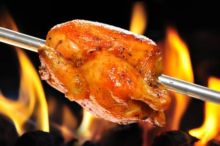 roasted chicken on flame background