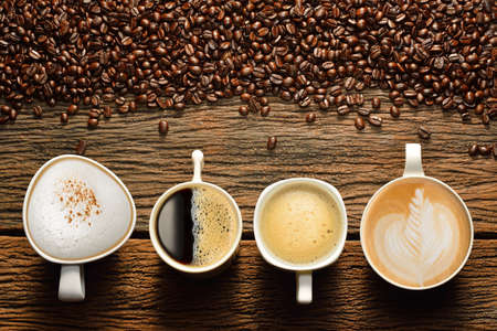 Photo pour Variety of cups of coffee and coffee beans on old wooden table - image libre de droit