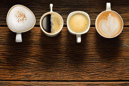 Photo pour Variety of cups of coffee on old wooden table - image libre de droit