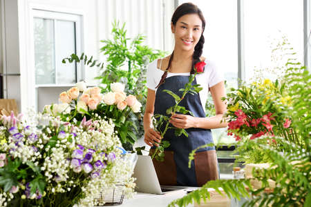 Photo for Young Asian woman entrepreneur/shop owner/ florist of a small flower shop business - Royalty Free Image