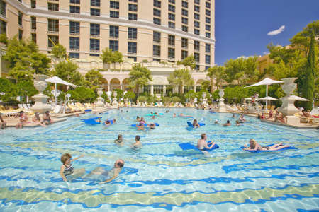 Large swimming pool with swimmers at Bellagio Casino in Las ...
