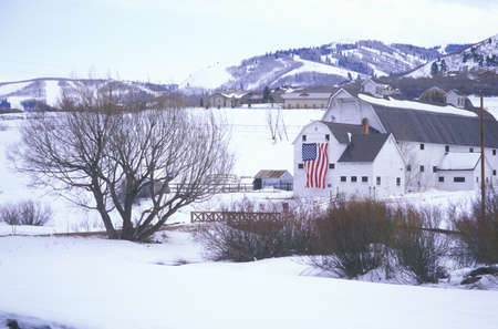 American Flag Hung on Barn in the snow, Park City, Utah