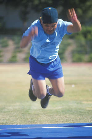 Special Olympics athlete in mid-air, competing, UCLA, CA