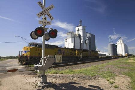 Freight train and blinking crossing light in Big Springs, Nebraska