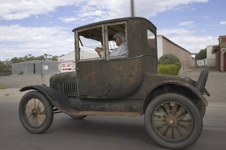 Model T Ford Hardtop car driving through Delta, Colorado