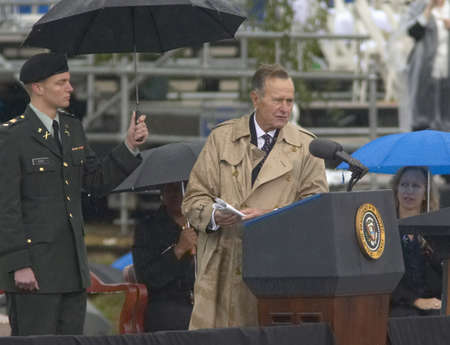 Former US President George HW Bush speaks during the grand opening ceremony of the William J. Clinton Presidential Center in Little Rock, AK 18 November 2004.