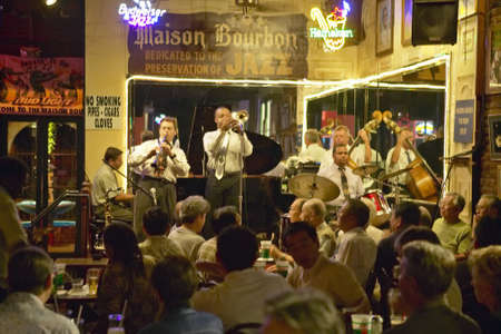 Maison Bourbon Jazz Club with Dixieland band and trumpet player performing at night in French Quarter in New Orleans, Louisiana