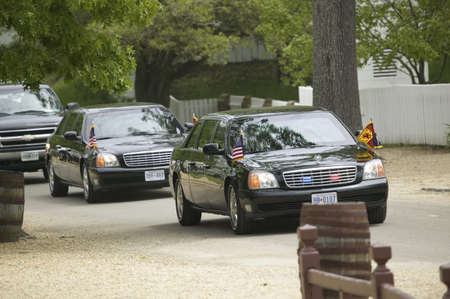 Black Presidential Limo and American Flag and motorcade pulling up in front of Governor's Palace in Williamsburg, Virginia on May 4, 2007