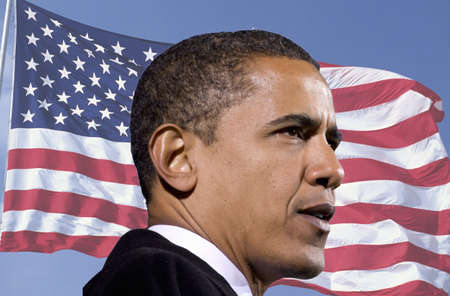 President Barack Obama waving against a backdrop of the flag of the United States of America