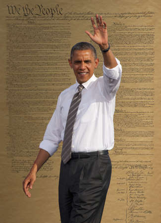 President Barack Obama waving against a backdrop of the United States Constitution