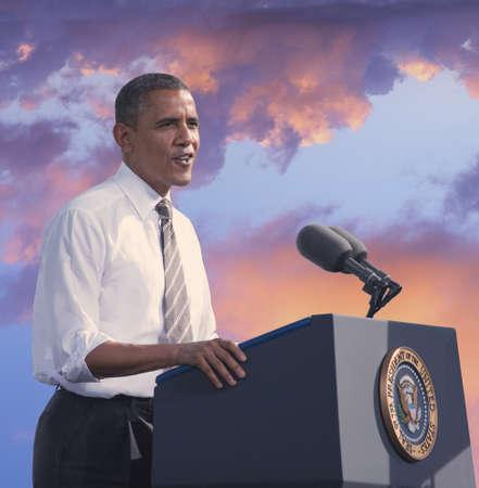 President Barack Obama speaking against a backdrop of a sunset