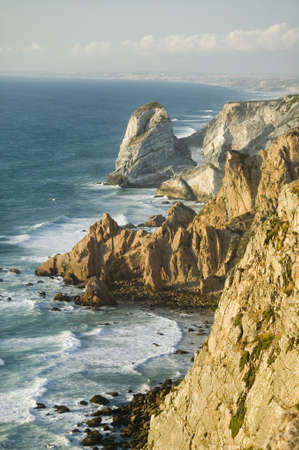 Cliffs of Cabo da Roca on the Atlantic Ocean in Sintra, Portugal, the westernmost point on the continent of Europe, which the poet Cam›es defined as where the land ends and the sea begins.