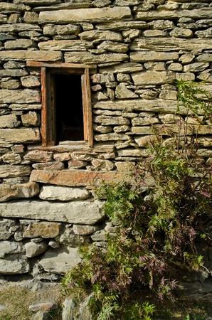 small wood window on a strength wall