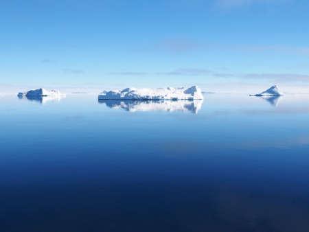 Antarctica blue iceberg landscape ocean mirrow reflection