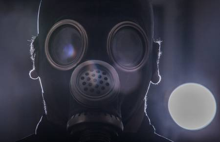 a man in a gas mask with the abstract background