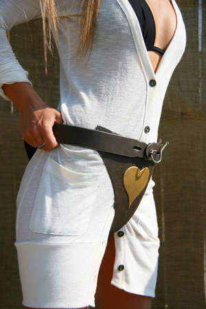 Chastity belt on a woman in white dress