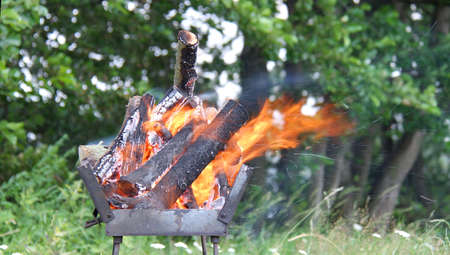 Flames burning in a barbecue standing in a garden
