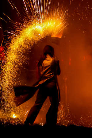Photo for Amazing fire show at nigh on street - Royalty Free Image