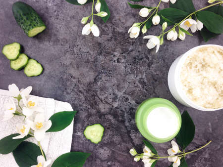Photo pour Set of spa treatment products and jasmine flowers on stone background. Flat lay - image libre de droit
