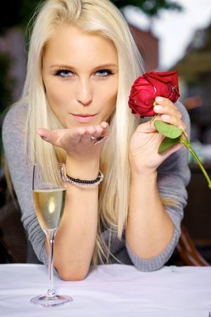 Young woman sending a romantic blow kiss.