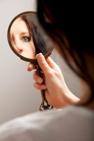 Photo pour Closeup of a mirror reflection of a woman's eye, selective focus - image libre de droit
