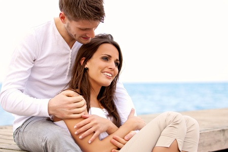 Photo pour Portrait of an attractive couple enjoying each other's company by the sea - image libre de droit