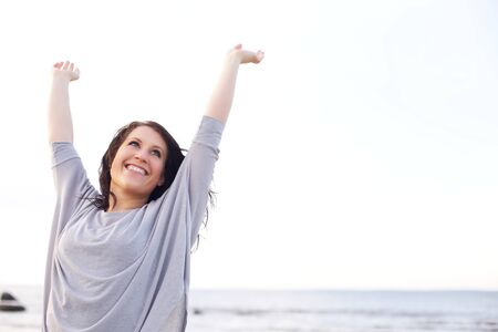Woman stretching her arms to welcome the brand new day