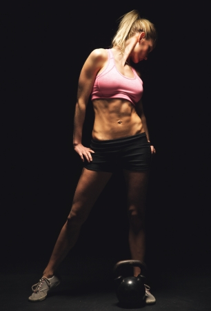Fitness woman standing and showing off her toned and muscular athletic body