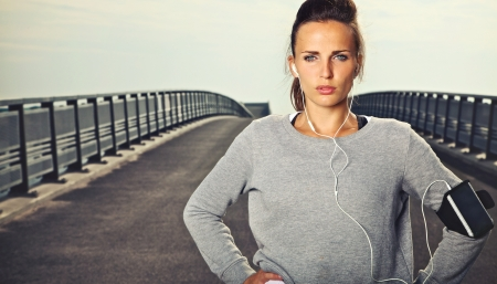 Serious female jogger outdoors looking confident