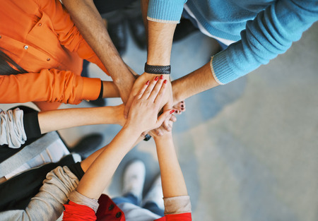 Photo for Top view image of group of young people putting their hands together. Friends with stack of hands showing unity. - Royalty Free Image