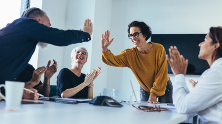 Photo for Business people giving each other high five and clapping. Business team celebrating success. - Royalty Free Image