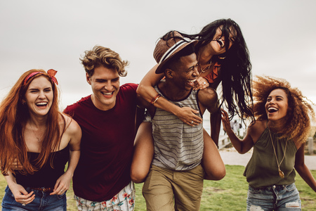 Photo for Multiracial group of friends hanging out and having fun outdoors. Young men and women enjoying outdoors on summer day. - Royalty Free Image