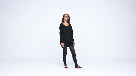 Photo pour Woman in eyeglasses isolated on white background. Fashionable woman with pierced lips and tattoo on hand looking at camera. - image libre de droit