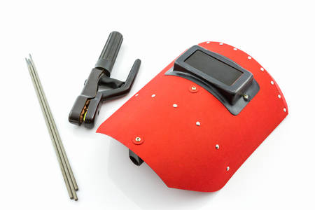 Red protective screen and rod-holder with Welding electrodes wire, for electric arc welding, on white background.