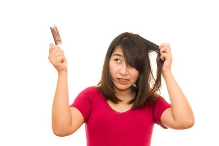 Foto de Asian girl worried about hair loss,Hair loss - Imagen libre de derechos