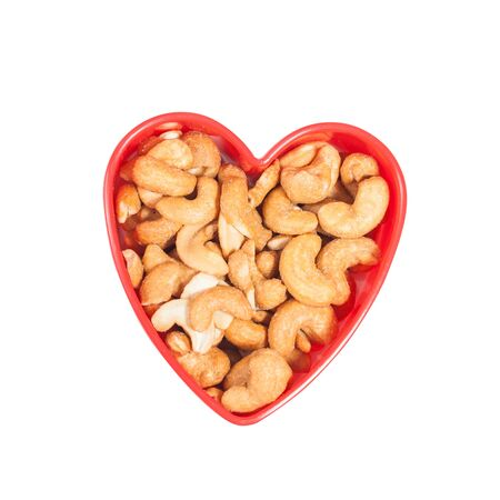 heart shape from cashew. Isolated on a white 