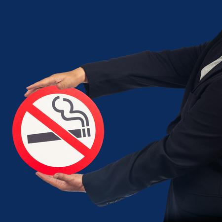 Foto de Business man show with no smoking sign ,health concept. - Imagen libre de derechos