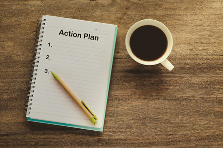 Photo for Action Plan text on book note with cup of coffee, pen. - Royalty Free Image