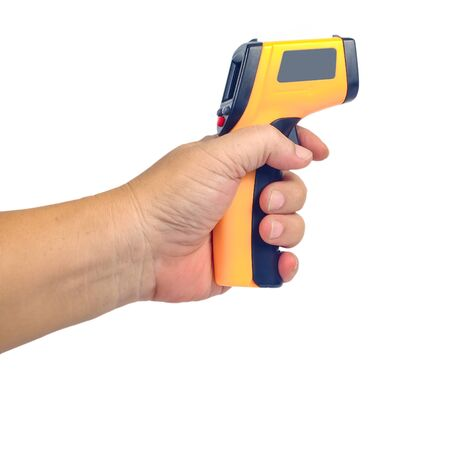 Photo for Yellow Infrared thermometer gun in hand used to measure temperature  on white background. - Royalty Free Image