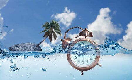 A  alarm clock  into water with a rocky island and coconut tree in the background. Concept  time not important on vacation.