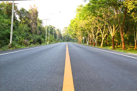 Empty of asphalt road in the countryside of Thailand, shallow focused