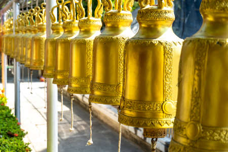 Brass bell lined in Thai temples. For people to knock with good luck and fend off bad.