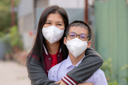 Photo for Mather and son with dust protection mask ( Safety Mask )on the street - Royalty Free Image