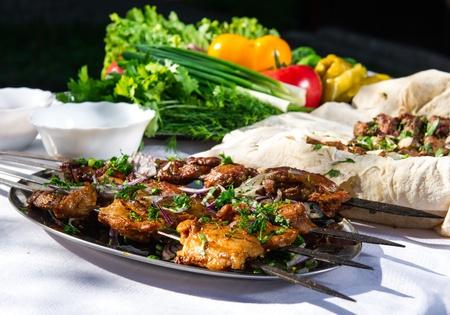 Shashlik with lavash and vegetables