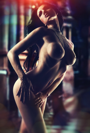 Naked brunette over abstract background