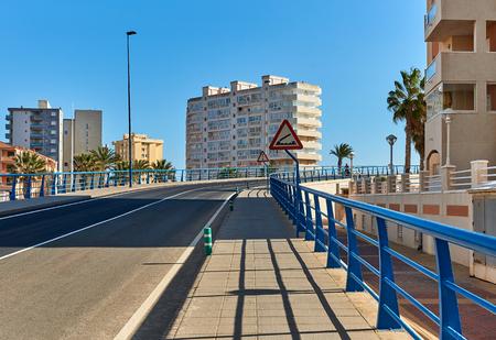 The 53 m long Bascule bridge of La Manga (La Manga del Mar Menor), in summer timetable it raises eight times a day. Region of Murcia, Spain.